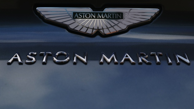 An Aston Martin badge sits on the hood of a DB11 AMR automobile parked outside the London Stock Exchange on the day of the trading debut of Aston Martin Lagonda Global Holdings Plc at the London Stock Exchange in London, U.K., on Wednesday, Oct. 3, 2018. Aston Martin is expected to price its U.K. initial public offering at 19 pounds ($24.66) per share, toward the bottom of a marketed range that it had already narrowed, according to people familiar with the matter. Photographer: Luke MacGregor/Bloomberg