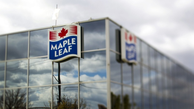 Maple Leaf Foods Inc. signage is displayed outside of the company's processing facility in the photo taken with a tilt-shift lens in Toronto, Ontario, Canada, on Monday, Oct. 17, 2011.