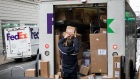 An independent contractor to FedEx Corp. unloads packages from a delivery truck on Cyber Monday in New York, U.S., on Monday, Dec. 2, 2019. The optics war between Amazon.com Inc. and its critics is intensifying on Cyber Monday with labor, environmental and digital privacy groups staging events around the globe to amplify their concerns about the world's biggest online retailer. Photographer: Michael Nagle/Bloomberg