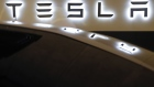 A Tesla logo is displayed on a Tesla Inc. Model S electric vehicle at a Supercharger station in Kriegstetten, Switzerland, on Thursday, Aug. 16, 2018. Tesla chief executive officer Elon Musk has captivated the financial world by blurting out via Twitter his vision of transforming Tesla into a private company. Photographer: Stefan Wermuth/Bloomberg
