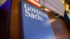 Goldman Sachs Group Inc. signage is displayed at the company's booth on the floor of the New York Stock Exchange (NYSE) in New York, U.S., on Tuesday, May 30, 2017. U.S. stocks halted a seven-day advance, while the dollar fluctuated as data showing a rebound in consumer spending offset a wider selloff in commodities. The euro slipped with equities in the region. Photographer: Bloomberg/Bloomberg