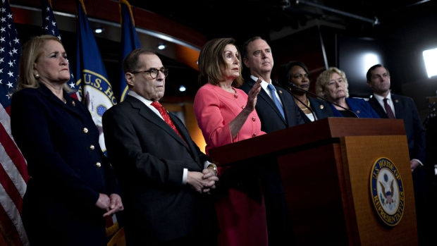 U.S. House Speaker Nancy Pelosi, a Democrat from California, center, speaks as Jason Crow, a Democrat from Colorado, from right, Representative Zoe Lofgren, a Democrat from California, Representative Val Demings, a Democrat from Florida, Representative Adam Schiff, a Democrat from California and chairman of the House Intelligence Committee, Representative Jerry Nadler, a Democrat from New York and chairman of the House Judiciary Committee, and Representative Sylvia Garcia, a Democrat from Texas, listen during a news conference on Capitol Hill in Washington, D.C. on Jan. 15, 2020. Photographer: Andrew Harrer/Bloomberg