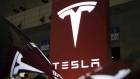 Tesla Motors Inc. logo is displayed at the Tesla Motors Inc. booth at the Cutting-Edge IT & Electronics Comprehensive Exhibition (CEATEC) at Makuhari Messe in Chiba, Japan, on Tuesday, Oct. 4, 2016. The show runs through Oct. 7. Photographer: Tomohiro Ohsumi/Bloomberg