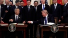 President Donald Trump signs a trade agreement with Chinese Vice Premier Liu He