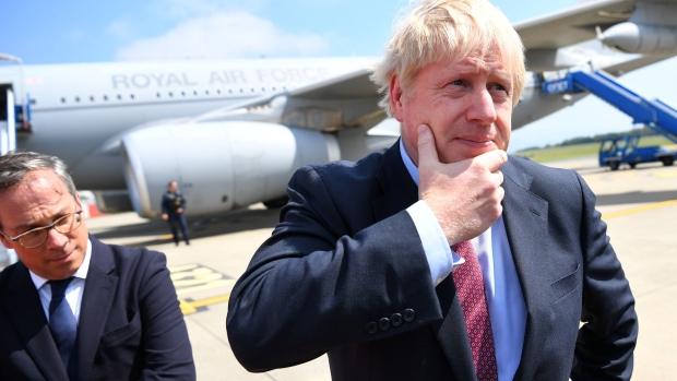 BIARRITZ, FRANCE - AUGUST 24: British Prime Minister Boris Johnson disembarks a plane as he arrives as Biarritz Pays Basque Airport for the G7 summit on August 24, 2019 in Biarritz, France. The French southwestern seaside resort of Biarritz is hosting the 45th G7 summit from August 24 to 26. High on the agenda will be the climate emergency, the US-China trade war, Britain's departure from the EU, and emergency talks on the Amazon wildfire crisis. (Photo by Dylan Martinez - Pool/Getty Images)