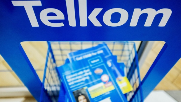 Information brochures sit on display inside a phone store operated by Telkom SA SOC Ltd. at the Menlyn Park shopping center in Pretoria, South Africa, on Tuesday, July 25, 2017. South Africa is evaluating assets it could sell to pay for this month's 2.2 billion rand ($169.5 million) bailout of unprofitable carrier South African Airways, Finance Minister Malusi Gigaba said in letter to parliament. Photographer: Waldo Swiegers/Bloomberg