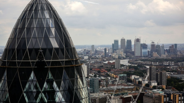 "30 St Mary Axe, also known as ""the Gherkin,"" stands in this view from the 22 Bishopsgate office tower construction project in the City of London, U.K., on Friday, Aug. 31, 2018. Axa SA's real estate unit and development partner Lipton Rogers Developments LLP are building the 278-meter (912 foot) Bishopsgate tower, which will become the tallest in the City of London financial district. Photographer: Simon Dawson/Bloomberg"