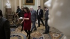 GETTY IMAGES - Mitch McConnell walks with staff and security as he arrives at the U.S. Capitol on Ja