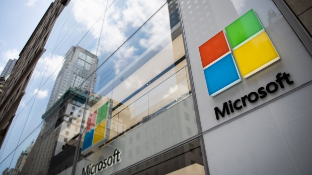 Signage is displayed on the exterior of the Microsoft Corp. flagship store in New York, U.S., on Saturday, July 14, 2018. Microsoft Corp. is scheduled to release earnings figures on July 19.