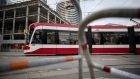 A Toronto Transit Commission (TTC) streetcar travels down a track in Toronto, Ontario