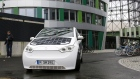 BERLIN, GERMANY - OCTOBER 11: A driver drives a Sono Motors Sion solar-powered electric car during a presentation event on October 11, 2017 in Berlin, Germany. Munich-based Sono Motors claims the car has a range of 250km and can charge its battery with its built-in solar cells at a rate of 30km per day. The car can also be charged with a plug. Sono Motors is accepting pre-orders for car, which retails for EUR 16,000, not including the battery. (Photo by Carsten Koall/Getty Images)