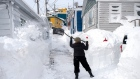 A resident clears snow in St. John's on Sunday, Jan. 19, 2020.