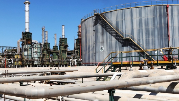 Refining towers and fuel storage tanks are seen at the zawiya oil refinery near tripoli libya