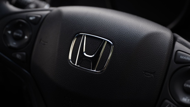 The Honda Motor Co. badge is displayed on the steering wheel of a vehicle at the company's showroom in Tokyo, Japan, on Tuesday, Aug. 1, 2017. Honda is scheduled to report first-quarter earnings figures today. Photographer: Kiyoshi Ota/Bloomberg