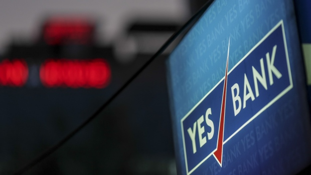 Signage is displayed outside a Yes Bank Ltd. branch in Mumbai, India, on Tuesday, April 30, 2018. Shares of Yes Bank slumped 29 percent on Tuesday, its biggest decline on record after the lender headed by newly appointed Chief Executive Officer Ravneet Gill reported a surprise quarterly loss. Photographer: Dhiraj Singh/Bloomberg