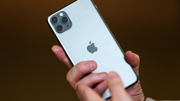 An attendee holds an Apple Inc. iPhone 11 smartphone at an Apple store during a product launch event in Sydney, Australia, on Friday, Sept. 20, 2019. Apple's new iPhones with camera enhancements and improved battery life go on sale today. Photographer: Brendon Thorne/Bloomberg