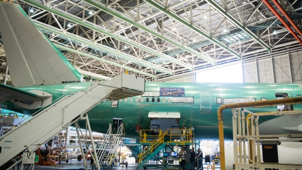 A Boeing Co. 777X folding wingtip during assembly in Everett.  Photographer: Chona Kasinger/Bloomberg