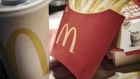 A McDonald's logo is displayed on a box of French fries inside one of the company's restaurants in Shanghai. Photographer: Qilai Shen/Bloomberg