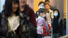 Passengers arrive at the international arrivals area at the Vancouver International Airport Jan 23