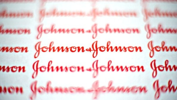 Johnson & Johnson logos are displayed for a photograph in Tiskilwa, Illinois, U.S., on Monday, April 11, 2011. Johnson & Johnson, the world's second-biggest seller of medical products, will pay $70 million after admitting that the company bribed doctors in Europe and paid kickbacks in Iraq to win contracts and sell drugs and artificial joints. Photographer: Bloomberg/Bloomberg
