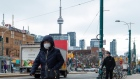 A pedestrian wears a protective mask in Toronto on Monday, January 27, 2020. The Canadian Press