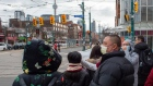 Pedestrians wear protective masks as they walk in Toronto on Monday, January 27, 2020. The Canadian