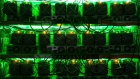 Lights illuminate as application-specific integrated circuit (ASIC) devices and power units operate inside a rack at the BitRiver Rus LLC cryptocurrency mining farm in Bratsk, Russia, on Friday, Nov. 8, 2019. Bitriver, the largest data center in the former Soviet Union, was opened just a year ago, but has already won clients from all over the world, including the U.S., Japan and China. Most of them mine bitcoins. Photographer: Andrey Rudakov/Bloomberg