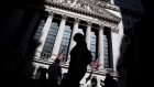 Pedestrians pass in front of the New York Stock Exchange (NYSE) in New York, U.S., on Friday, May 24, 2019. U.S. equities climbed at the end of a bruising week in which escalating trade tensions dominated markets.