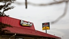 Signage is displayed outside a Yum! Brands Inc. Pizza Hut restaurant in Morris, Illinois, U.S., on Tuesday, Feb. 5, 2019.