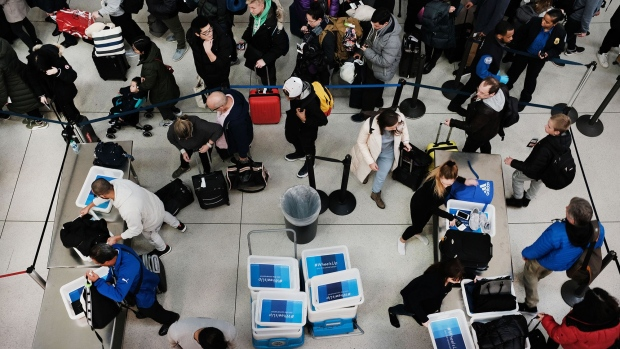 Passengers wait in a Transportation Security Administration (TSA) line at JFK airport on January 09, 2019 in New York City. Photographer: Spencer Platt/Getty Images