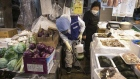 A worker in protective gear sterilizes a food grocery against the novel coronavirus in Seoul, on Feb. 7.