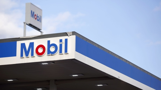 Signage is displayed at an Exxon Mobil Corp. gas station in Columbus, Indiana, U.S., on Tuesday, Jan. 29, 2019. Soaring production in North America's most prolific oil field helped propel Exxon Mobil Corp. to bigger-than-expected fourth-quarter profits. Photographer: Luke Sharrett/Bloomberg
