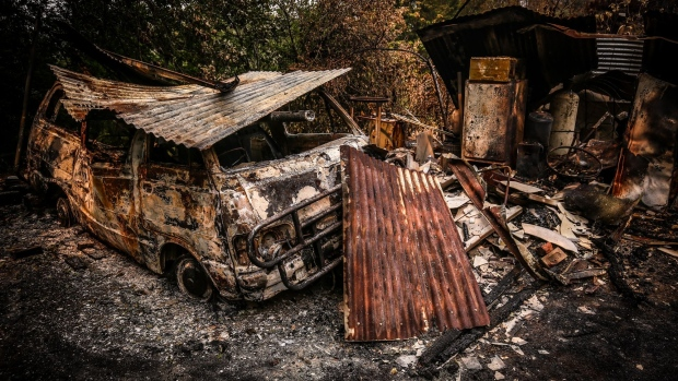 A burned vehicle sits outside a home destroyed by bushfires near the town of Bilpin, New South Wales, Australia, on Sunday, Dec. 29, 2019. With a state of emergency declared in New South Wales state, and toxic smoke shrouding Sydney for several days this month, the spotlight has been turned on Prime Minister Scott Morrison's conservative government, which champions the coal industry and has dismissed calls to take more steps to curb emissions. Photographer: David Gray/Bloomberg
