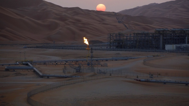 A flame burns from a stack at the oil processing facility at Saudi Aramco's Shaybah oil field in the Rub' Al-Khali desert, also known as the 'Empty Quarter,' in Shaybah, Saudi Arabia, on Tuesday, Oct. 2, 2018. Saudi Arabia is seeking to transform its crude-dependent economy by developing new industries, and is pushing into petrochemicals as a way to earn more from its energy deposits. Photographer: Simon Dawson/Bloomberg