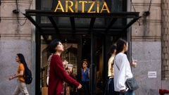 Pedestrians pass in front of an Aritzia Inc. store in New York, U.S.,
