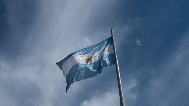An Argentine flag stands on display in Plaza de Mayo in Buenos Aires, Argentina, on Monday, Sept. 2, 2019. Argentines and investors alike are cautiously assessing the impact of President Mauricio Macri's decision to impose capital controls on Sunday -- a blunt policy reversal aimed at containing the country's escalating financial crisis. Photographer: Erica Canepa/Bloomberg