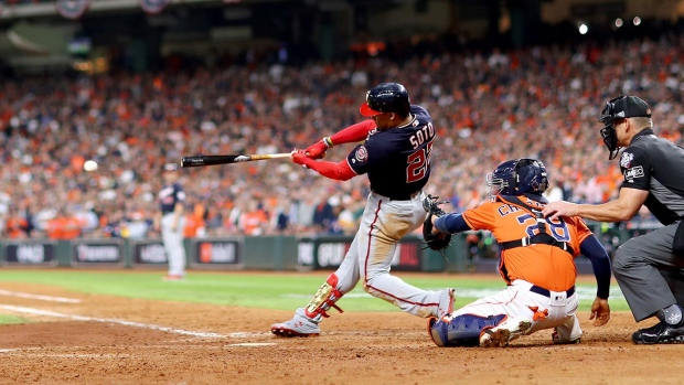Juan Soto #22 of the Washington Nationals hits an RBI single against the Houston Astros during the eighth inning in Game Seven of the 2019 World Series at Minute Maid Park on October 30, 2019 in Houston.