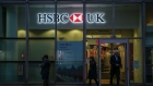 A sign featuring a HSBC Holdings Plc logo hangs outside a bank branch in London, U.K., on Wednesday, Nov. 6, 2019. The U.K. is headed to the polls on Dec. 12, bringing banks, utilities and housebuilders into focus for U.K. equity investors. Photographer: Hollie Adams/Bloomberg