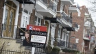 "A ""For Sale"" sign is displayed outside a home in the Le Plateau Mont-Royal borough of Montreal, Quebec, Canada, on Saturday, April 14, 2018. An economic revival in Canada's second-biggest city is fueling a long-awaited real-estate renaissance, shrinking inventories, speeding up sales and luring foreign buyers. Photographer: Christinne Muschi/Bloomberg"