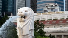 The Merlion statue stands at the Marina Bay waterfront as the Fullerton Hotel stands in the background in Singapore, on Sunday, June 10, 2018. U.S. President Donald Trump and North Korean leader Kim Jong Un will hold their historic Singapore summit at the Capella Hotel on the city-states Sentosa Island on June 12. Photographer: SeongJoon Cho/Bloomberg