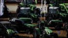 Attendees browse Same Deutz-Fahr Schweiz AG tractors during the World Agriculture Expo in Tulare, California, U.S., on Wednesday, Feb. 12, 2020. The annual World AG Expo has more than 1,450 exhibitors displaying the latest in farm equipment, chemicals, communications, and technology. Photographer: Patrick T. Fallon/Bloomberg