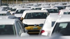 A Volkswagen AG (VW) Golf automobile, center, sits with other VW cars in a parking lot at Willy Brandt Berlin Brandenburg International Airport in Schoenefeld, Germany, on Friday, Aug. 17, 2018.