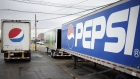 Delivery trucks sit parked outside the Pepsi Beverages Co. plant in Louisville, Kentucky, U.S., on Sunday, Feb. 11, 2018. PepsiCo Inc. is scheduled to release earnings figures on February 13. Photographer: Luke Sharrett/Bloomberg
