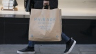 A pedestrian carries a shopping bag from a Primark clothing store, operated by Associated British Foods Plc, in London, U.K., on Monday, Feb. 10, 2020. European retailers are likely to see coronavirus fallout spread from Chinese retail sales to supply chains, causing disruptions globally and affecting profit, according to Bloomberg Intelligence. Photographer: Jason Alden/Bloomberg