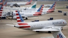 American Airlines Group Inc. planes stand at Dallas-Fort Worth International Airport (DFW) in Grapevine, Texas, U.S., on Friday, April 6, 2018. Photographer: Patrick T. Fallon/Bloomberg