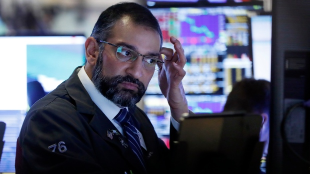 Trader Aman Patel works on the floor of the New York Stock Exchange, Tuesday, Feb. 25, 2020. AP