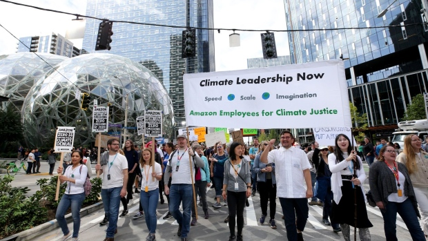 EATTLE, WA - SEPTEMBER 20: Amazon and other tech employees walkout past the Amazon Spheres during the Global Climate Strike on Sept. 20, 2019 in Seattle, Washington.
