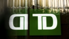 Toronto-Dominion (TD) Canada Trust signage is reflected on a building in the financial district of Toronto, Ontario, Canada, on Thursday, July 25, 2019.