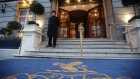 A doorman stands at the entrance to The Ritz Hotel, London.