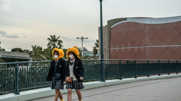 TOKYO, JAPAN - FEBRUARY 28: Schoolgirls wearing face masks and novelty hats leave Tokyo Disneyland on the day it announced it will close until March 15th because of concerns over the Covid-19 virus, on February 28, 2020 in Tokyo, Japan.